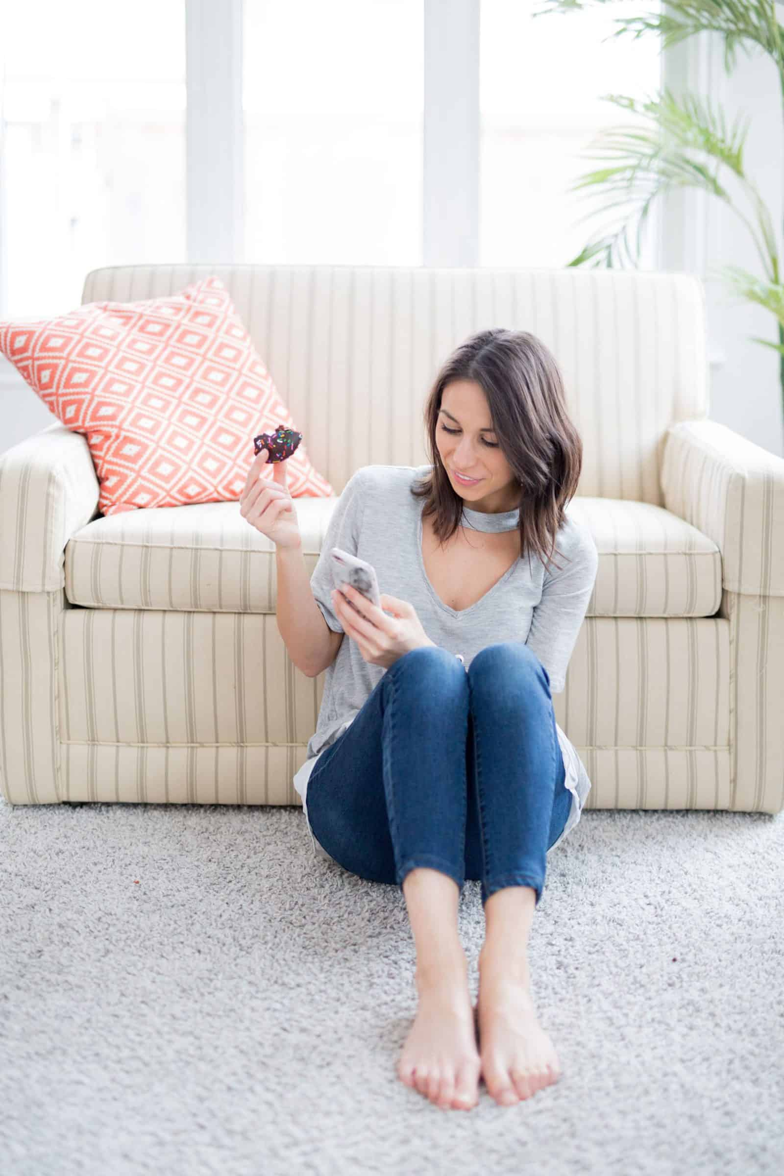 woman sitting on carpet leaning on couch